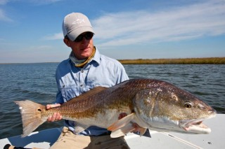 Capt Andy Parker with bull red caught on fly