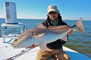 Capt Christian Yergens with a slob redfish