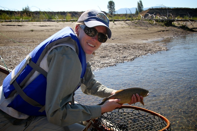 Carolyn with a nice Snake River cutthroat caught on a fly fishing guide trip