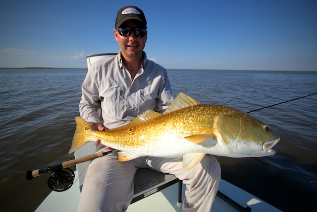Bucky with bull redfish caught with Spotted Tail Outdoors
